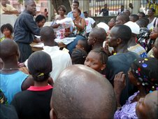 People rush for free mosquito nets at Freetown's children's hospital.