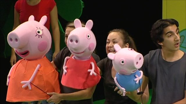 Peppa Pig puppets with puppeteers on stage