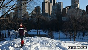 A woman on skis in New York&#039;s Central Park on 27 December 