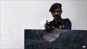 An Indian policeman stands guard outside a government office in Mumbai