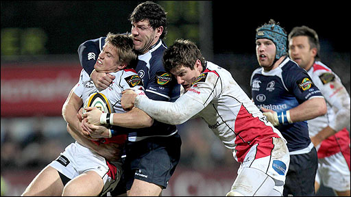 Ulster fly-half Niall O'Connor is grabbed by Leinster's Shane Horgan as Robbie Diack moves in