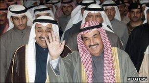 Kuwait's Prime Minister Sheikh Nasser al-Mohammad al-Sabah waves as he leaves the parliament building in Kuwait December 28, 2010