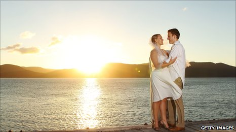 Denise and Mark Duffield-Thomas pose after renewing their vows for the 79th time at Daydream Island Resort in Australia