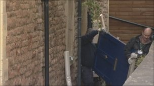 Police remove the front door of Ms Yeates' flat