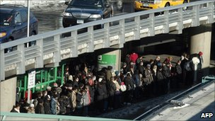 Passengers line up for taxis at La Guardia airport