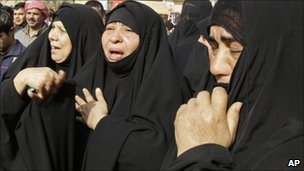 Women mourn relatives killed by a bomb in Baghdad, Iraq (15 Dec 2010)