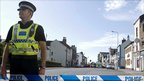 A police officer guards the scene of a shooting, on Duke Street in Whitehaven, Cumbria