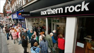 Customers wait in line to remove their savings from a branch of The Northern Rock bank on September 17, 2007 in Kingston-Upon-Thames, England.