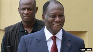 Alassane Ouattara (front) arrives for a meeting with his government at the Golf Hotel, his headquarters in Abidjan December 27, 2010. 