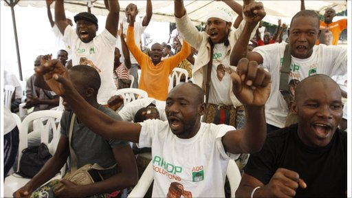 Supporters of opposition leader Alassane Ouattara, make their feelings known
