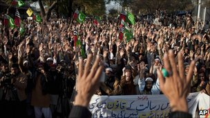 Protesters in Islamabad on 31 December 2010