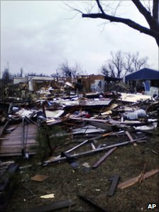 Debris left on the ground after a home and barn were destroyed by the tornado