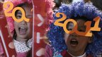 Children wear festive glasses at new year celebrations in Hong Kong