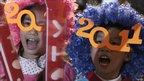 Children wear festive glasses at new year celebrations in Hong Kong