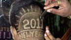 A man has a new year design shaved into his head in Karad, India