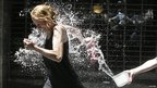 People working in the Montevideo financial district throw water at each other to celebrate the end of the year in Montevideo, Uruguay
