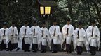 Shinto priests walk through Tokyo's Meiji Shrine to attend new year rituals