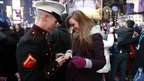 Chris Abaire puts engagement ring on Kirsten Razz's finger, Times Square, New York (31 December 2010).