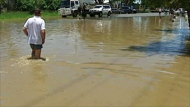 Man wading in floodwater