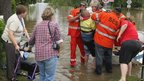Dell Rutherford is evacuated from her flooded home in Chinchilla, Queensland