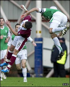 Ian Black is felled by Hibs' Ian Murray