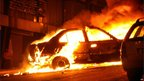 Blazing car outside Alexandria church, 1 Jan 11