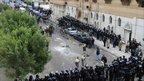 Police cordon near church after attack, 1 Jan 11