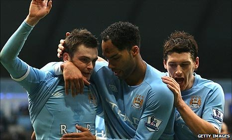 Man City celebrate Adam Johnson's first-half goal