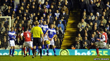 Robin van Persie curls in Arsenal's opener from a free-kick