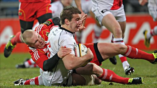 Ulster's TJ Anderson scores a try despite the efforts of Munster's Keith Earls