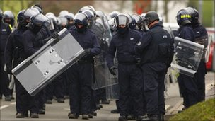 Specialist prison officers gather as they prepare to escort firefighters at HMP Ford near Arundel, West Sussex, after a riot broke out on 1 January 2011