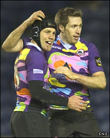 Simon Webster congratulates try scorer Jim Thompson