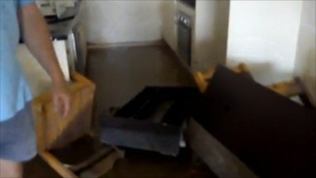 Alex Finlayson filmed inside his flooded home