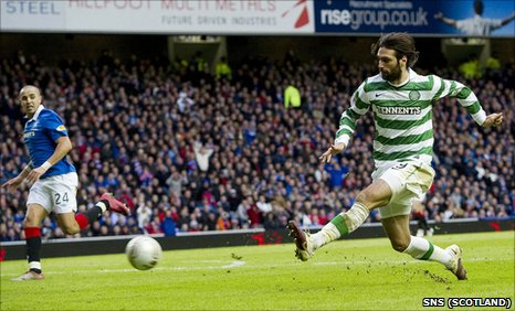 Georgios Samaras tucks  in the opening goal at Ibrox