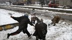 Kashmiri children throw snowballs at each other in Srinagar on 30 Dec 2010