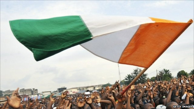 Ivory Coast flag is waved in a crowd