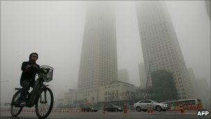 A cyclist in Beijing smog