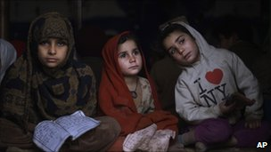 Child refugees learn how to read the Koran at a mosque in an Islamabad slum