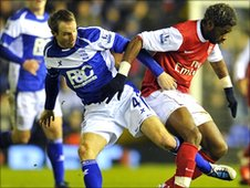 Lee Bowyer tackles Alex Song during Saturday's match