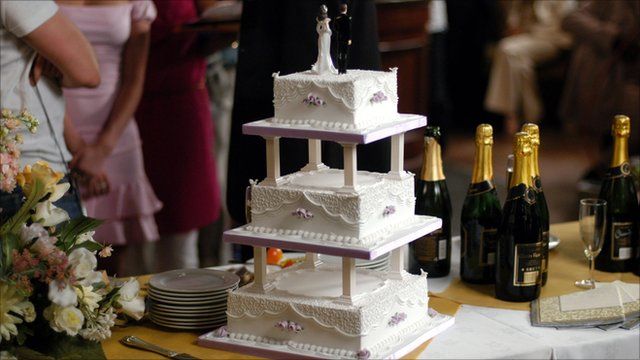 Wedding cake and wine bottles