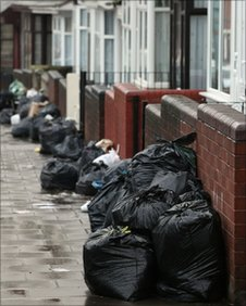 Rubbish bags piled up in a Birmingham street