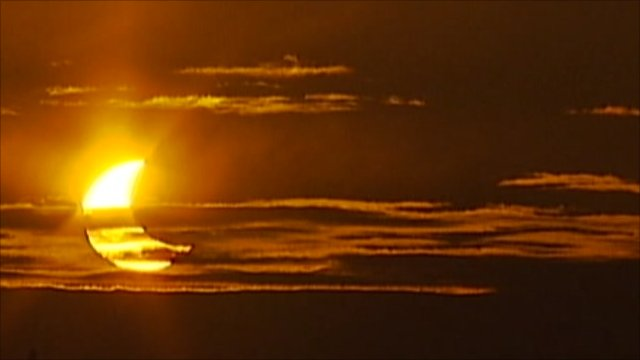 Partial solar eclipse as seen at sunrise in Sweden