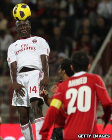 Rodney Strasser of Sierra Leone (heading the ball) in action for his club side AC Milan