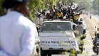 Southern Sudanese ride in a truck as they chant slogans in support of the referendum on southern independence in Juba