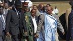 South Sudan's leader Salva Kiir (l) and Sudan's President Omar al-Bashir at Juba airport