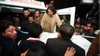PPP supporters move the body of Salman Taseer from an ambulance in Islamabad 