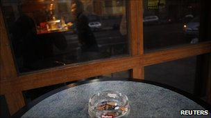 An ashtray stands on a table outside a bar in Madrid, 2 January
