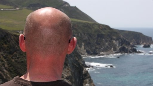 bald man by the sea