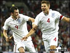 Steven Gerrard (right) and Adam Johnson