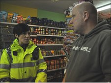 PCSO Renata Dudek with shopkeeper in Yeovil